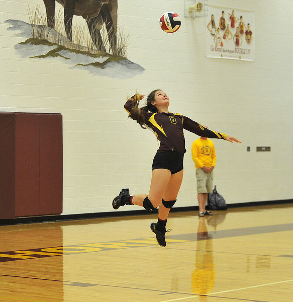 Ryan Patterson | The Sheridan Press<br /> Big Horn's Cheyann Price serves against Tongue River at Big Horn High School Saturday, Sept. 22, 2018. Big Horn defeated Tongue River 25-18, 25-22, 25-14.