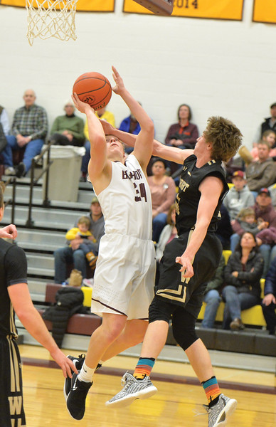 Bud Denega | The Sheridan Press<br /> Big Horn's Quinn McCafferty rises up through contact during the Rams' game against Wright at Big Horn High School Friday, Feb. 15, 2019.