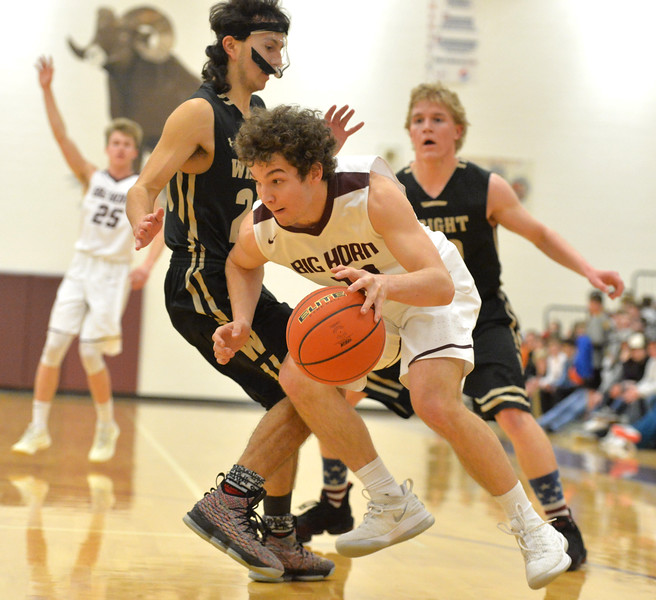 Bud Denega | The Sheridan Press<br /> Big Horn's Kade Eisele dribbles the ball during the Rams' game against Wright at Big Horn High School Friday, Feb. 15, 2019.