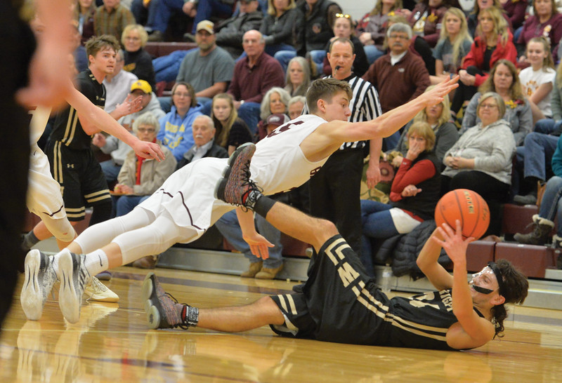 Bud Denega | The Sheridan Press<br /> Big Horn's Will Pelissier dives for the ball during the Rams' game against Wright at Big Horn High School Friday, Feb. 15, 2019.