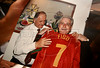 Ben Hur, friend of Portugal football coach Luiz Felipe Scolari, displays a photo of Scolari with presenting a Portugal jersey to Joaquim Amaral, a Portuguese national who lives in Brazil in this photo taken in Porto alegre in Brazil's southern Rio Grande do Sul state, April 27, 2006. The Portuguese national coach, who led Brazil to the 2002 World Cup title, has accepted the job as Chelsea's coach. (Australfoto/Douglas Engle)