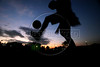 A boy practices football as part of a program run by a friend of Portugal football coach Luiz Felipe Scolari in Porto Alegre, in Brazil's southern Rio Grande do Sul state, April 27, 2006. The Portuguese national coach, who led Brazil to the 2002 World Cup title, has accepted the job as Chelsea's coach. (Australfoto/Douglas Engle)