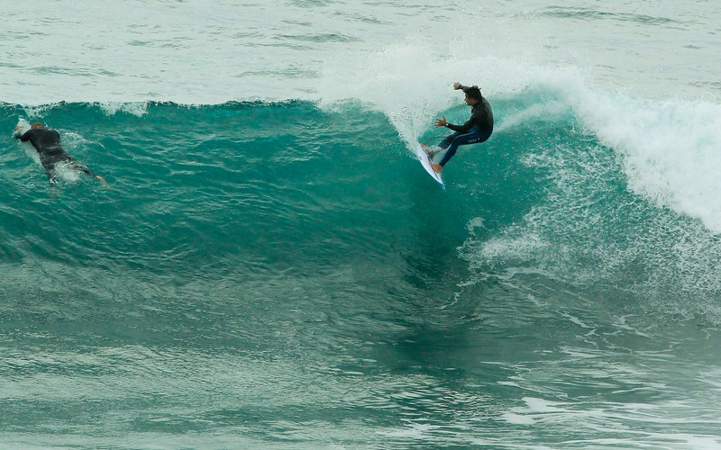 It takes guts just to get in the water with waves like this, much less ride them.