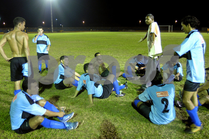 "Manager Alex Oliveira, standing second from right, gives his team, Combatente, a pep talk during halftime of an amateur league game at the ""Big Zero"" Stadium, on the equator in Macapa, capital of the Brazilian state of Amapa, Dec. 1, 2004. One half of the stadium is in the Northern Hemisphere, the other in the Southern Hemisphere."