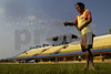 "A groundskeeper waters the grass of the ""Big Zero"" Stadium on the equator in Macapa, capital of the Brazilian state of Amapa, Dec. 2, 2004. One half of the stadium is in the Northern Hemisphere, the other in the Southern Hemisphere."