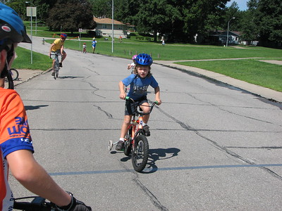 Alexi Wall winning the Pella, IA kid's bike race from 6 others with Chelsea Wall at left