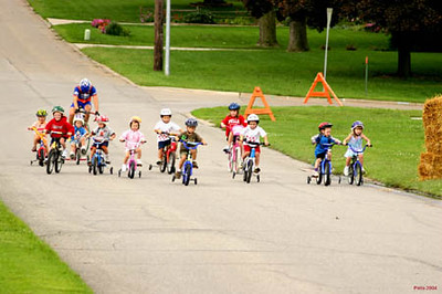 Start of the Kid's race in Pella, IA. Alexi Wall is on the tricycle in front of Scott Wall at the back. Pella Bike Club Photo.