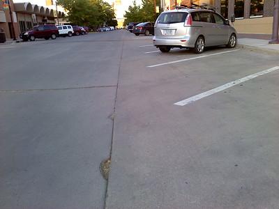 Divot on Main Street halfway between Clark & Burnett Avenues