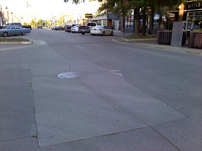 Pavement divot in center of intersection of Main Street & Douglas Avenue