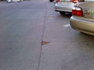 Divot in pavement on Main Street just east of Burnett Avenue