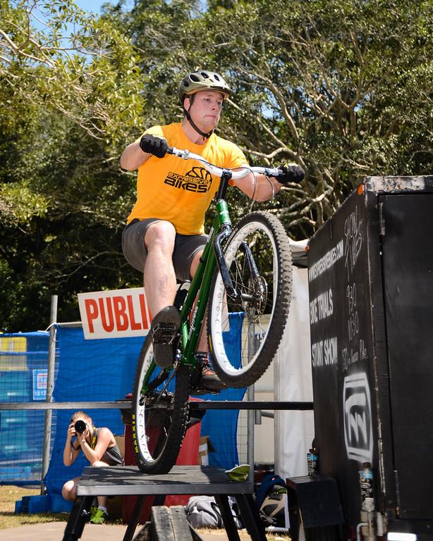 """Lewis Greenhalgh - ExpressiveBikes Bike Trials Stunt Team - 2013 Super Saturday at the Noosa Triathlon Multi Sport Festival, Noosa Heads, Sunshine Coast, Queensland, Australia. Camera 1. Photos by Des Thureson - <a href=""""http://disci.smugmug.com"""">http://disci.smugmug.com</a>"""