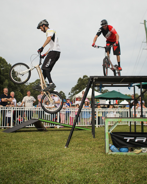 Tim Mullaly, Kyle Rolands - 2015 Expressivebikes.com Bike Trials Stunt Team at the Green Heart Fair, Brisbane, Queensland, Australia; Sunday 31 May 2015. Photos by Des Thureson.