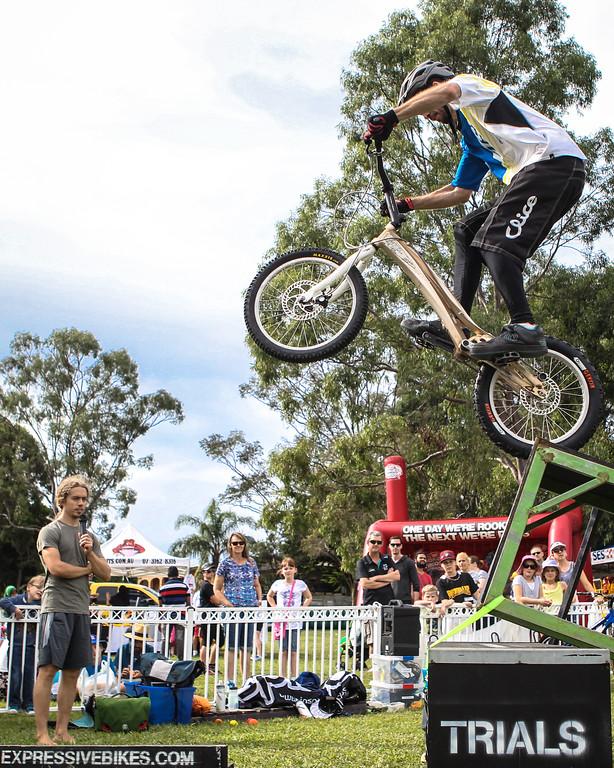 Alternate Processing: Matt's Dramatic Sky Level 3 - Tim Mullaly - 2015 Expressivebikes.com Bike Trials Stunt Team at the Green Heart Fair, Brisbane, Queensland, Australia; Sunday 31 May 2015. Photos by Des Thureson.