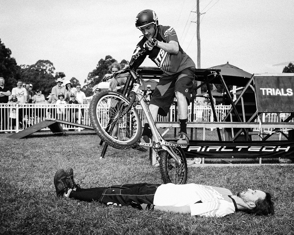 Alternate Processing: B&W Look 3 - Tim Mullaly, Kyle Rolands - 2015 Expressivebikes.com Bike Trials Stunt Team at the Green Heart Fair, Brisbane, Queensland, Australia; Sunday 31 May 2015. Photos by Des Thureson.