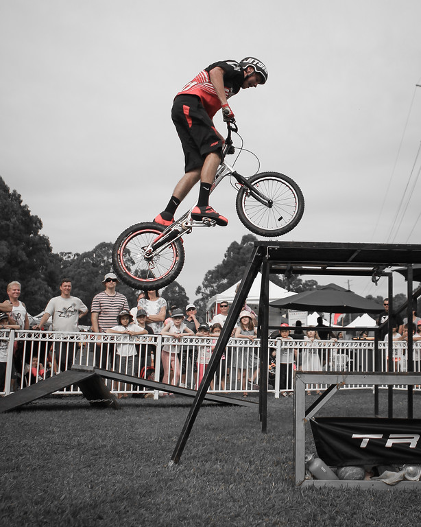 Alternate Processing: Matt's Sin City Light Red - Kyle Rolands - 2015 Expressivebikes.com Bike Trials Stunt Team at the Green Heart Fair, Brisbane, Queensland, Australia; Sunday 31 May 2015. Photos by Des Thureson.