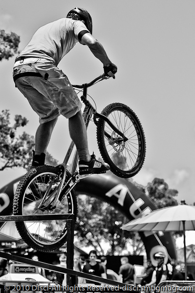 "Alternate Processing: ""Hardcore Acros"" - Lewis Greenhalgh - Expressivebikes.com bike trials demo team at the 2010 Noosa Triathlon Multi Sport Festival, 30 October 2010. Noosa Heads, Sunshine Coast, Queensland, Australia."