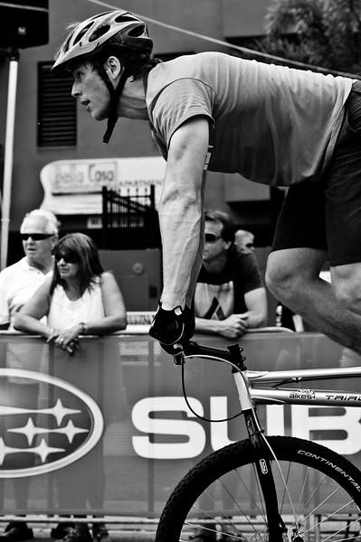 "Alternate Processing: ""Stark Raging Black"" - Lewis Greenhalgh - ExpressiveBikes Bike Trials Demo Team - Super Saturday at the Noosa Triathlon Multi Sport Festival, Noosa Heads, Sunshine Coast, Queensland, Australia; 29 October 2011."