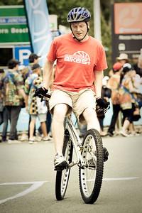 "Alternate Processing: ""Steller Guru GreenGold"" - Tony Leyland - ExpressiveBikes Bike Trials Demo Team - Super Saturday at the Noosa Triathlon Multi Sport Festival, Noosa Heads, Sunshine Coast, Queensland, Australia; 29 October 2011."