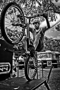 "Alternate Processing: ""Hardcore Acros"" - Borys Zagrocki - 2011 Expressivebikes.com Bike Trials Demo Team at the Noosa Triathlon Multi Sport Festival Expo, Noosa Heads, Sunshine Coast, Queensland, Australia; 29 October 2011."