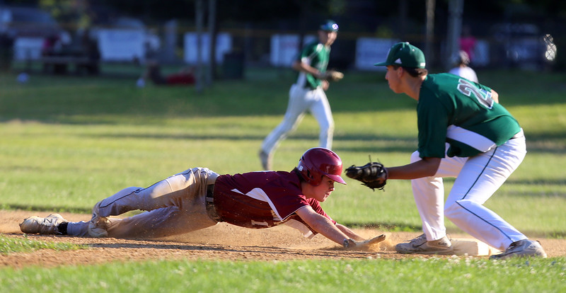 Lowell vs Billerica in Northeast League summer baseball. Lowell's Brian Hoey (15) dives back safely to first, Billerica first baseman Billy Rose (21) fielding, in the bottom of the third inning. (SUN/Julia Malakie)