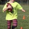 Rylie Becker, 6, of Billerica, at Merrimack Valley Pop Warner football skills clinic at Lampson Field. (SUN/Julia Malakie)