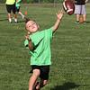 Jakob Hawkes, 4, of Billerica, throwing at Merrimack Valley Pop Warner football skills clinic at Lampson Field. (SUN/Julia Malakie)