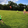 Merrimack Valley Pop Warner football skills clinic at Lampson Field. Jakob Hawkes, 4, of Bilerica, does a running/passing drill with instructor Steven Giordano of Billerica. (SUN/Julia Malakie)