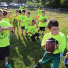 Merrimack Valley Pop Warner football skills clinic at Lampson Field. Timmy Murphy, 8, of Billerica, takes a turn throwing for distance. (SUN/Julia Malakie)