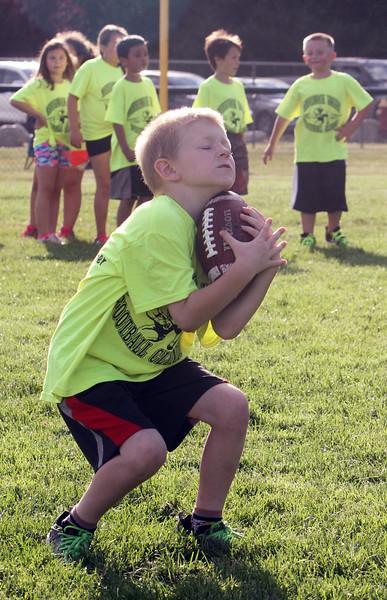 Merrimack Valley Pop Warner football skills clinic at Lampson Field. Thomas Peters, 6, of Lowell. (SUN/Julia Malakie)
