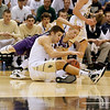 Record-Eagle/Jan-Michael Stump<br /> Traverse City St. Francis' Kody Kleinrichert (3) and Shelby's Cody Stotler (3) fight for a loose ball in Thursday's Class C state semifinal game at the Breslin Center in East Lansing.