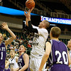 Record-Eagle/Jan-Michael Stump<br /> Traverse City St. Francis' Sean Sheldon (31) shoots over Shelby's Lucas Landis (21), Jeremiah James (44) and David Beckman, Jr. (20) in the second half of Thursday's Class C state semifinal game at the Breslin Center in East Lansing.