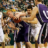 Record-Eagle/Jan-Michael Stump<br /> Traverse City St. Francis' Kody Kleinrichert (3) and Shelby's Jeremiah James (44) fight for the ball in the second half of Thursday's Class C state semifinal game at the Breslin Center in East Lansing.