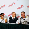 Record-Eagle/Jan-Michael Stump<br /> From left, Traverse City St. Francis's Devin Sheehy, coach Keith Haske and Sean Sheldon talk to members of the press following Thursday's 63-54 win over Shelby in Thursday's Class C state semifinal game at the Breslin Center in East Lansing.