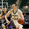 Record-Eagle/Jan-Michael Stump<br /> Traverse City St. Francis' Nick Clear (5) drives past Shelby's Jason Beckman (1) in the second half of Thursday's Class C state semifinal game at the Breslin Center in East Lansing.
