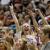 Record-Eagle/Jan-Michael Stump<br /> Traverse City St. Francis student Kenzie Feeney (cq),17, celebrates with classmates Thursday's 63-54 win over Shelby in the Class C state semifinal game at the Breslin Center in East Lansing.