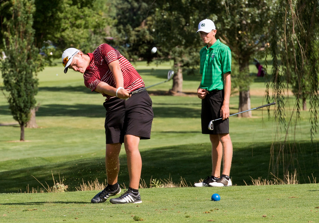 . Silver Creek\'s Dietrich Berning, left, tees off while Niwot\'s Jack Hoover, right, watches Thursday afternoon August 11, 2016 during Northern Conference Golf action at the Olde Course in Loveland. More photos: BoCoPreps.com (Photo by Michael Brian/Loveland Reporter-Herald)