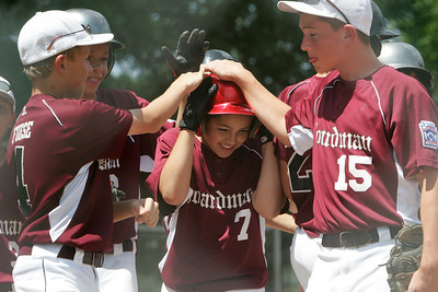 Boardman's Gino Beato belts a two run home run against Ashtabula in a Loser's Bracket game at Elyria East park and is congratulated at home plate by his teammates. Story by Bob Daniels  photo by Chuck Humel