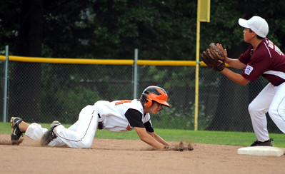Mt. Vernon Logan Jones returns safe on a rundown play to second base in front of Boardman Gino Beato in first inning July 28.   Steve Manheim