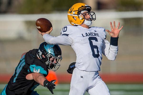 Quarterback Brock Samuels (6) passes the ball down the field, at Farmington High School, on Friday November 1, 2019.