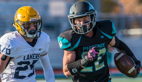 Jeremy Wilcox (22) of Farmington makes a reception and runs it in for a touchdown as Bonneville's Ty Stephens chases him down. In Farmington on Friday November 1, 2019.