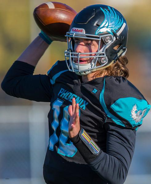 Wyatt Evertsen (18) quarterback of the Farmington finds a open receiver to pass to, against Bonneville High School, In Farmington on Friday November 1, 2019.