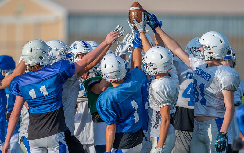 Fremont football team huddle at the end of practice. At Fremont High School, on August 3, 2020.