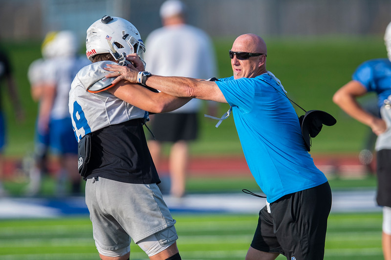 Fremont coach Ross Arnold demonstrates the correct technique to his players. In Plain City, on August 3, 2020.