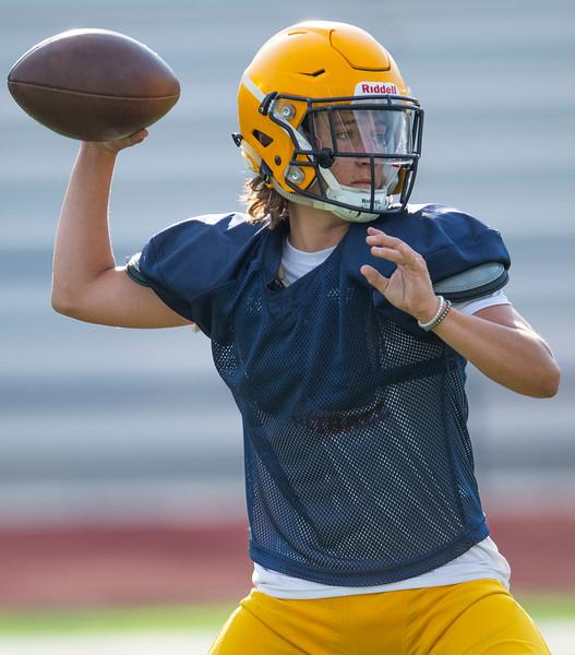 Bo Dixon, quarterback of Bonneville runs through passing drills to get ready for the season. At Bonneville High School, on August 3, 2020.