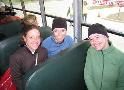 Three speedy women - Sandy, Debbie, and Michelle on the bus enroute to Hopkinton