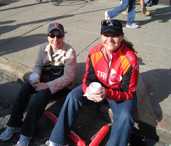 Sunday 4/20 at the US Women's Olympic Marathon Trials in downtown Boston - Tracy and Michelle taking a curbside break