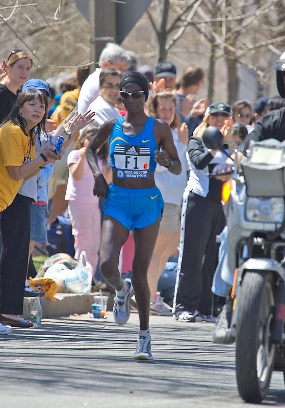 "<h3>This is Catherine Ndereba of Kenya in the middle of ""Heartbreak Hill"" in Newton, about 7 miles from the finish of today's Boston Marathon. Her win today is her fourth victory in this race.</h3>"