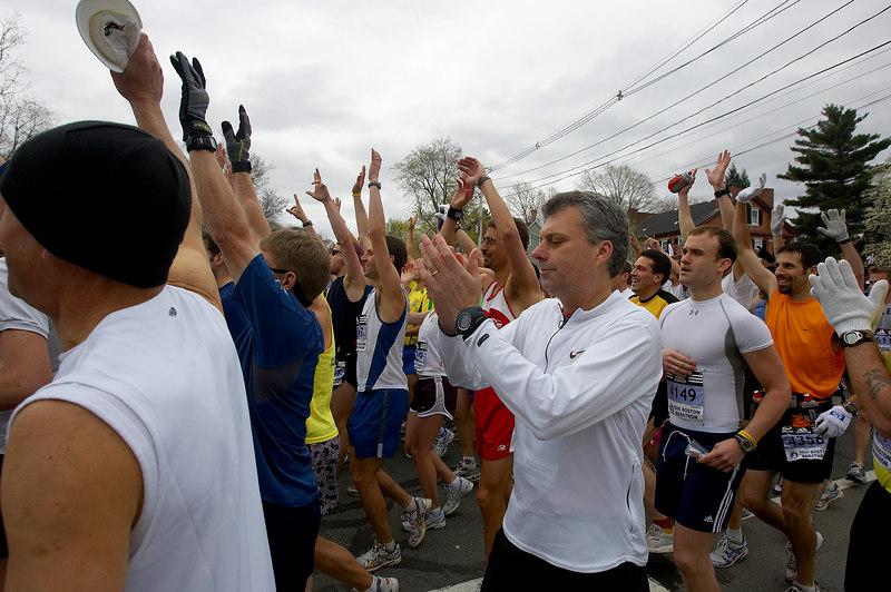 Runners celebrate the start of the 2006 Boston Marathon in Hopkinton, Mass., Monday, April 17, 2006.