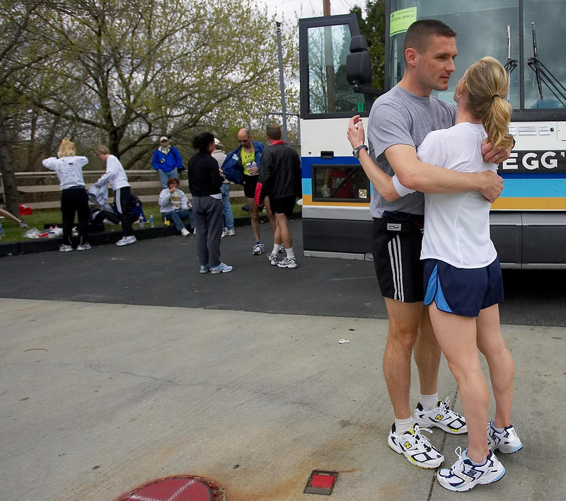 Amy Blithe of Wilmington, Delaware, right, embraces her husband, Joseph, before heading off to the starting corrals of the 2006 Boston Marathon in Hopkinton, Mass. on Monday, April 17, 2006.  Amy Blithe was the top female finisher among Delaware runners, clocking 3 hours, 12 minutes and 25 seconds, while her husband finished in 3 hours, 37 minutes and 27 seconds.  (For the Delaware News Journal)