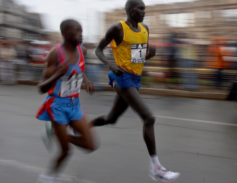Robert K. Cheruiyo of Kenya, right, leads fellow countryman James Kwambai through Coolidge Corner during the 2007 Boston Marathon.   Cheruiyo won his third Boston in 2:14:13.